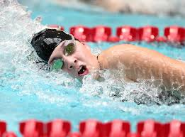 Junior Nicole Seavall, swimming the 500 Freestyle