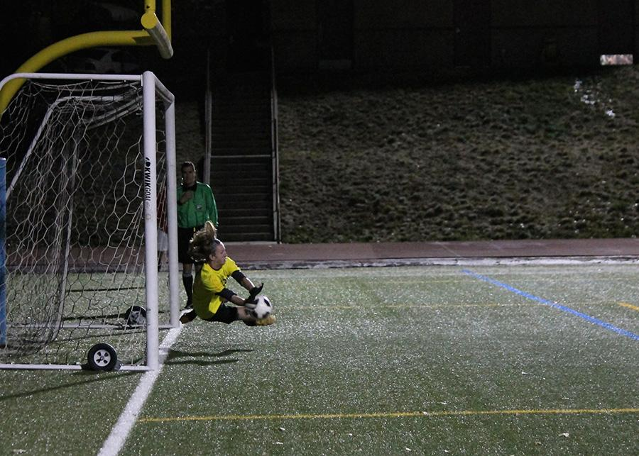 Sophomore Spencer Cobb saves one of  two penalties to lift Arapahoe above the Raiders
