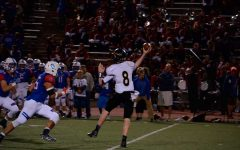 Quarterback Connor Desch throws a pass against Cherry Creek on Thursday night.