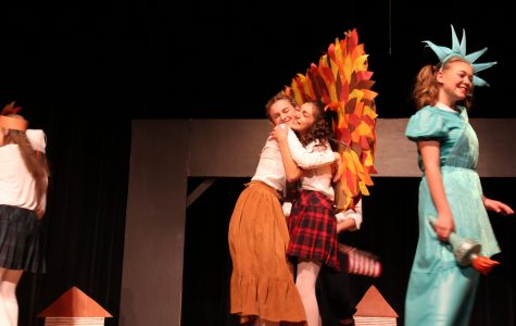 Young Shirley hugging her best friend, Evie Slotnick (Jordan Johnsan) after the Thanksgiving Pagent
