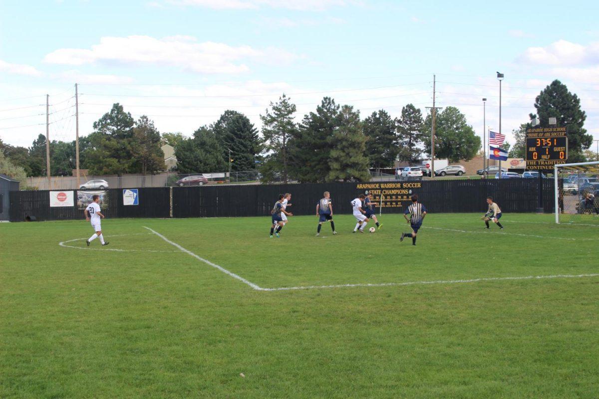 Mullen fends off Arapahoe's attempt to score