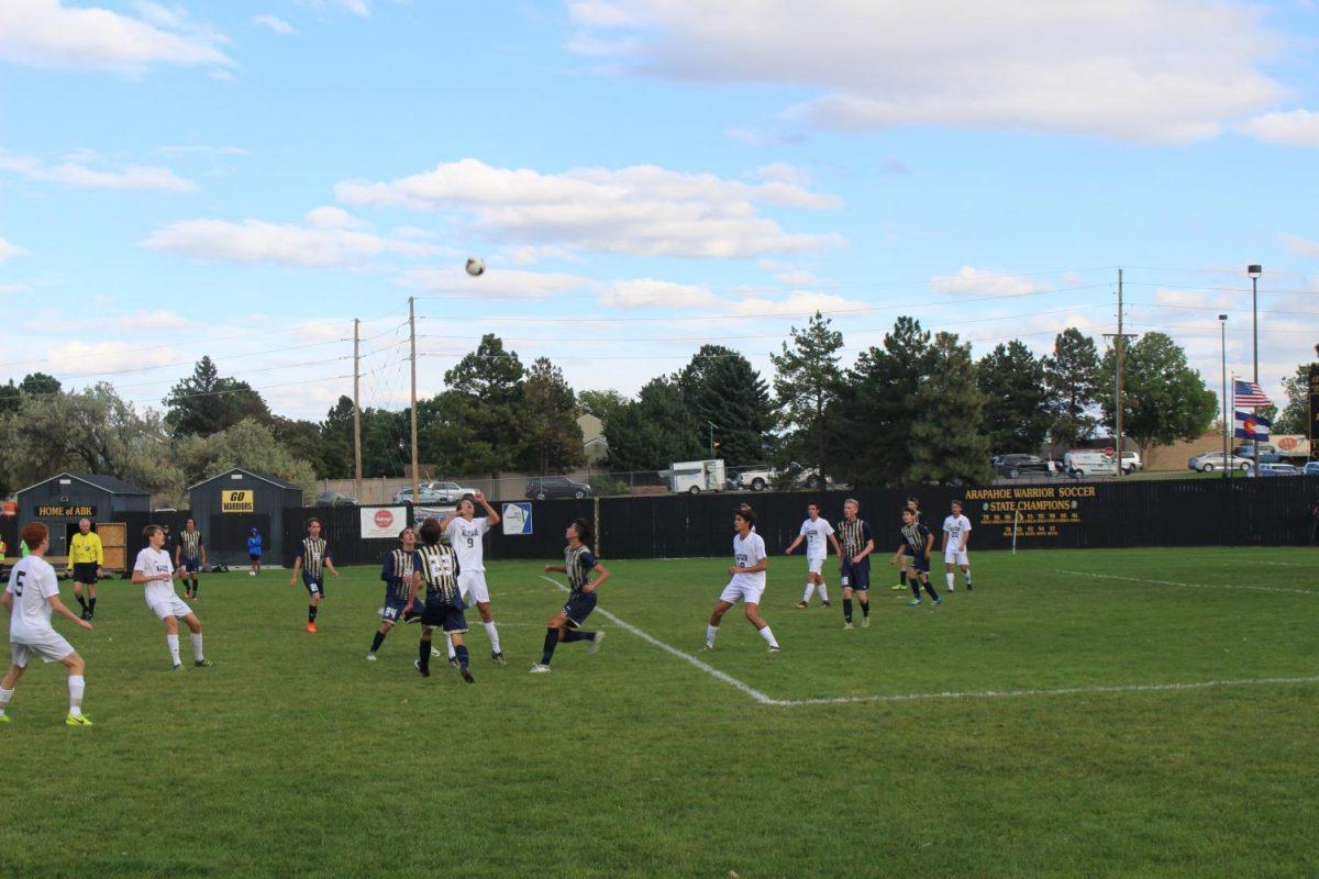 Arapahoe's #9 prepares to gain possession of of the ball