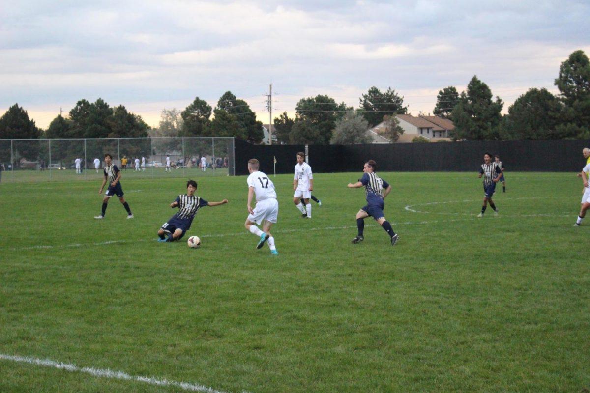 Mullen tries to get ball around Arapahoe's #17