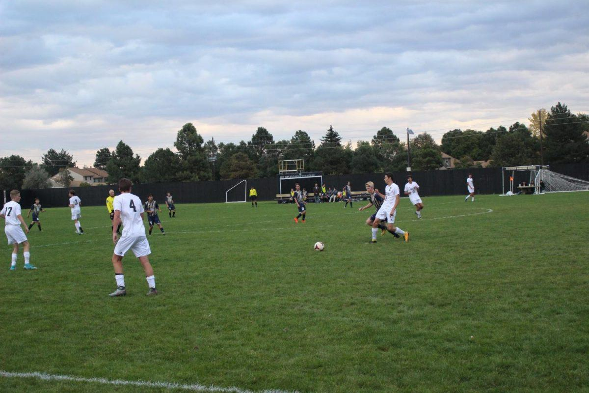 Arapahoe and Mullen fight for possession