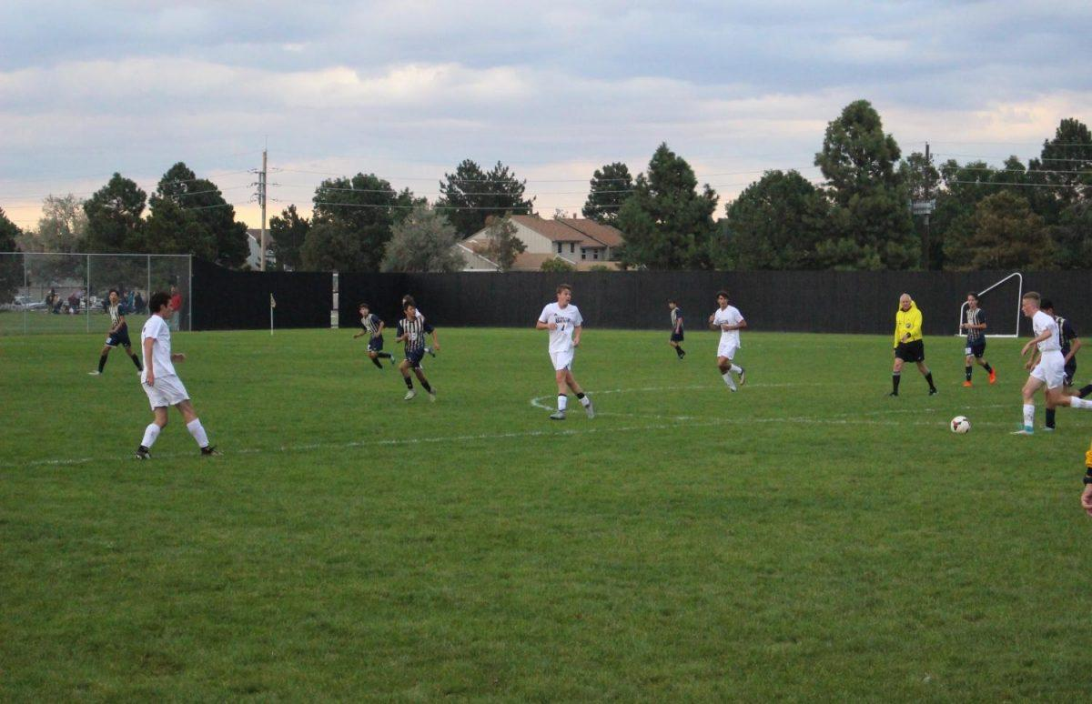 Arapahoe works their way down the field