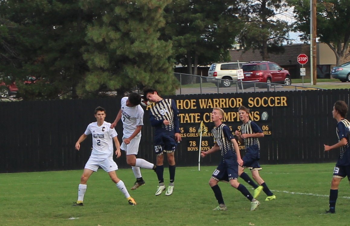 Arapahoe and Mullen fighting for the header