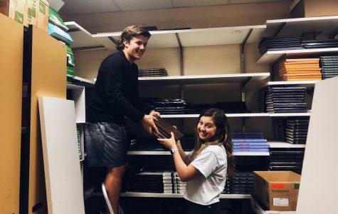 Devin Luedke (12) and Maggie Coan (12) renovate a closet into a podcast room.