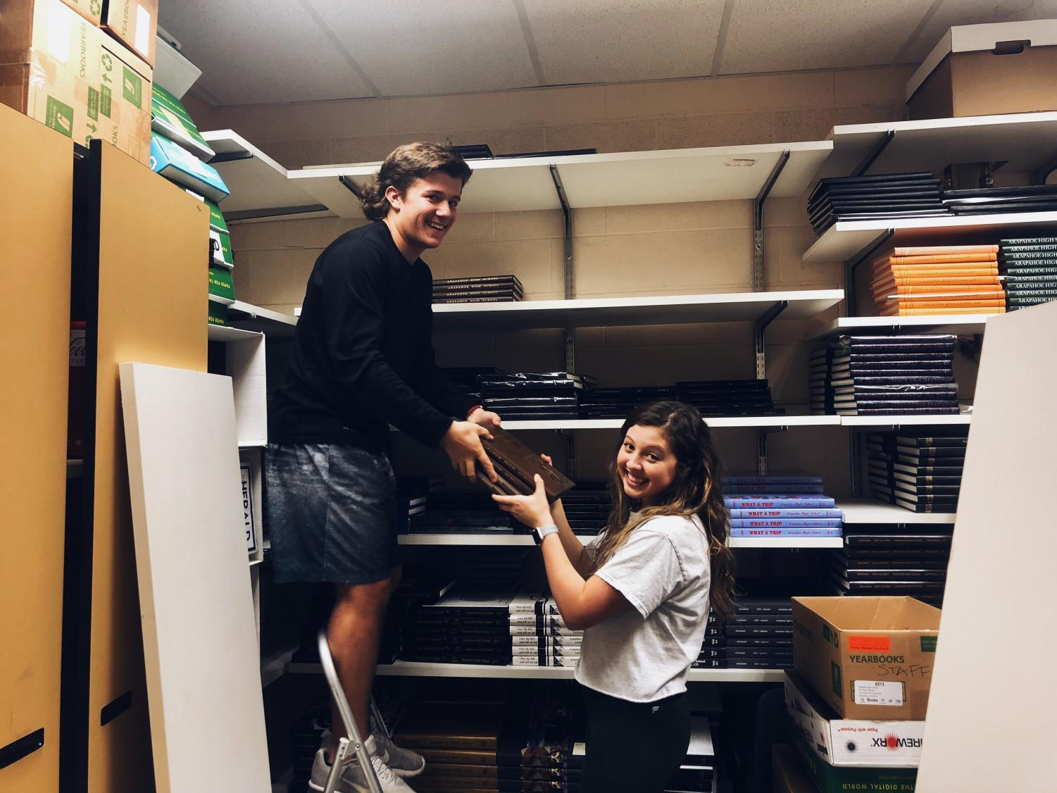 Devin Luedke (12) and Maggie Coan (12) renovate a closet into a podcast room.