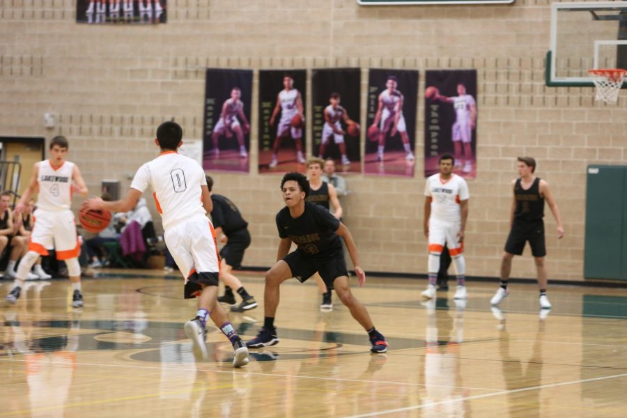 Arapahoe Basketball Teams Face Heritage