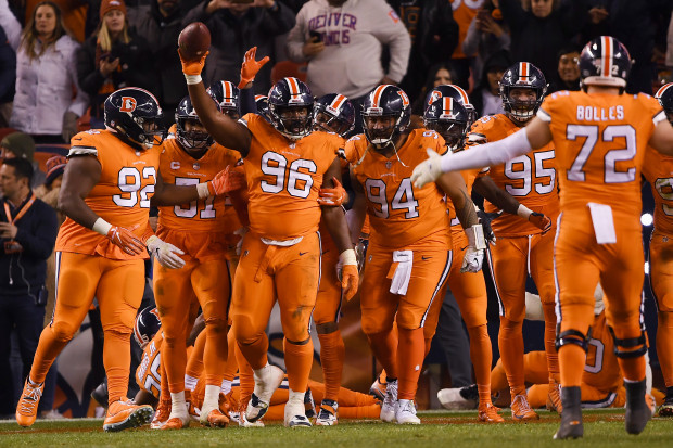 DENVER, CO - NOVEMBER 25: Shelby Harris (96) of the Denver Broncos celebrates an interception in the end zone during the fourth quarter against the Pittsburgh Steelers. the Denver Broncos won 24-17. The Denver Broncos hosted the Pittsburgh Steelers at Broncos Stadium at Mile High in Denver, Colorado on Sunday, November 25, 2018. (Photo by Joe Amon/The Denver Post)