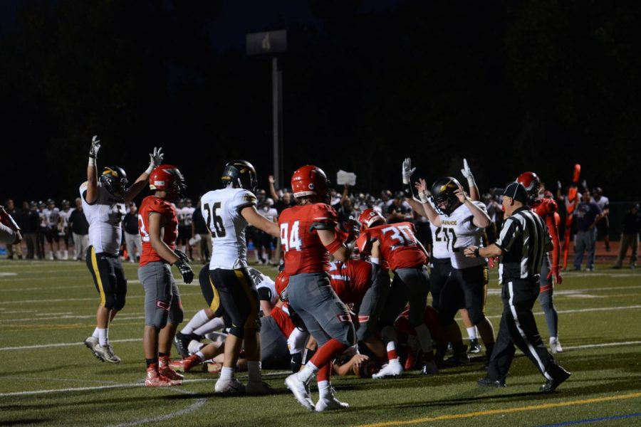 Warrior Football celebrates last year after scoring a touchdown vs Heritage in 2018. The game ended in a 24-28 loss.