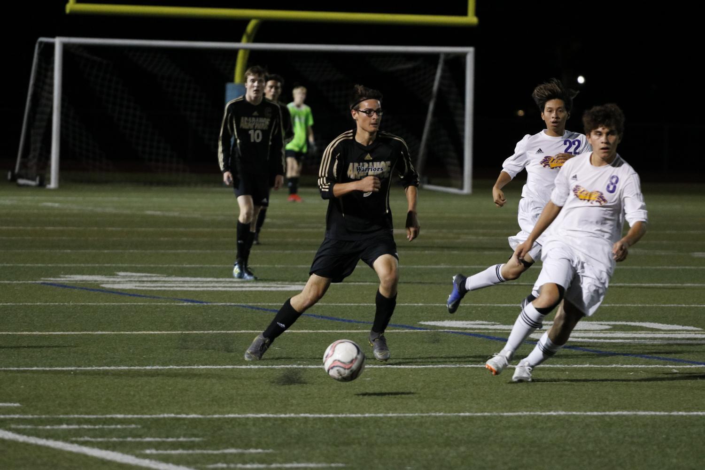 Junior Isaac Vigoren dribbles the ball down the field in a game against Littleton High School.