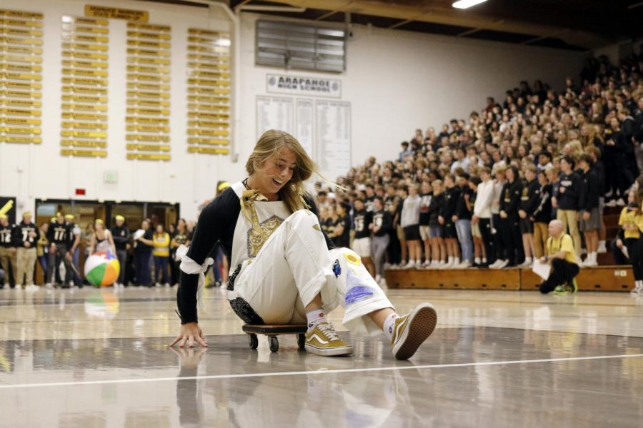 Friday, November 1st: Lauren Mabry (12) races against her fellow Warriors at the Homecoming Pep assembly.