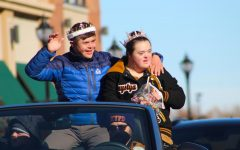 Saturday, November 2nd: Homecoming King Noah Stokes (12) and Homecoming Queen Khrystya Gordon (12) wave at the crowd during Arapahoe's annual Homecoming parade.
