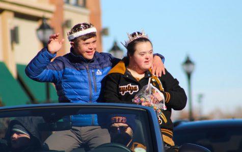 Saturday, November 2nd: Homecoming King Noah Stokes (12) and Homecoming Queen Khrystya Gordon (12) wave at the crowd during Arapahoe's annual Homecoming parade.