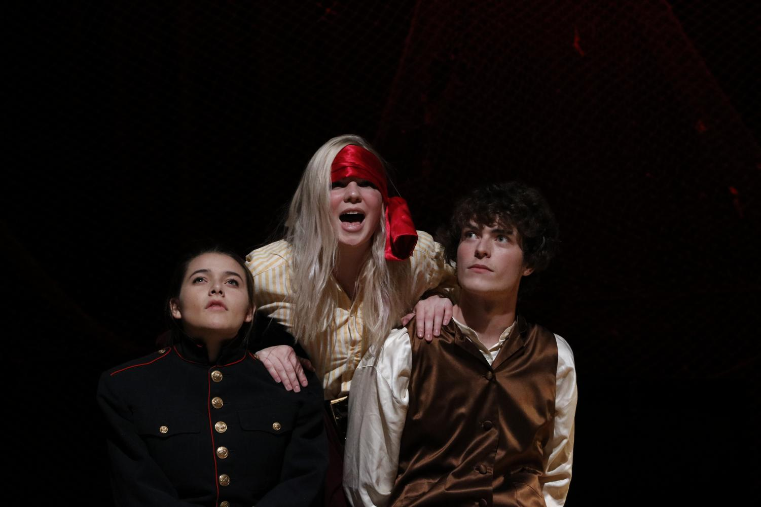 Beebe (middle) acts alongside Ellie Olsen, 12, and Ethan Lahm, 12, in the fall play Peter and the Starcatcher.